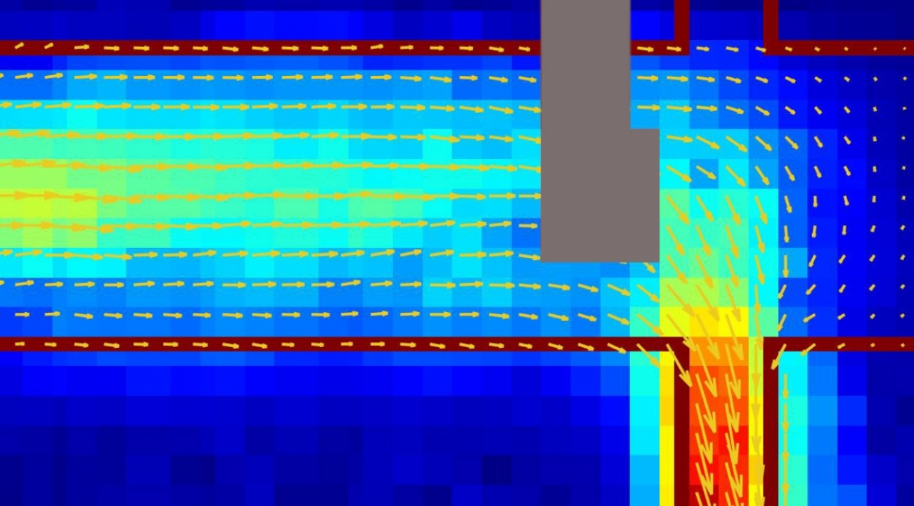 A colorful computer-generated map of the electrical current in a graphene channel that makes a sharp turn.
